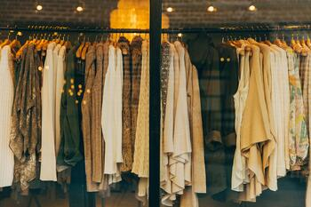 Women's clothing hanging in store window