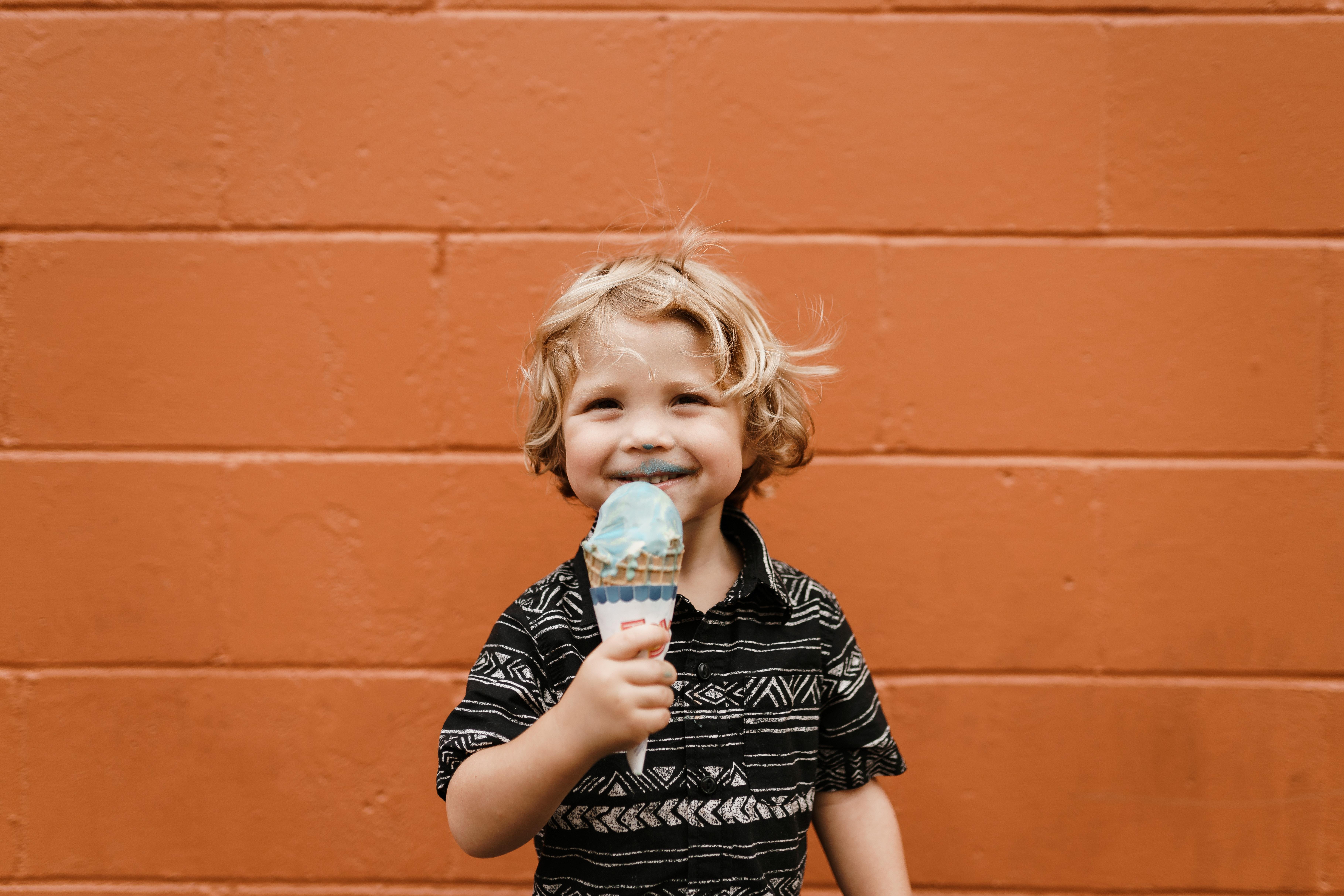 Smiling little boy eating ice cream.jpg