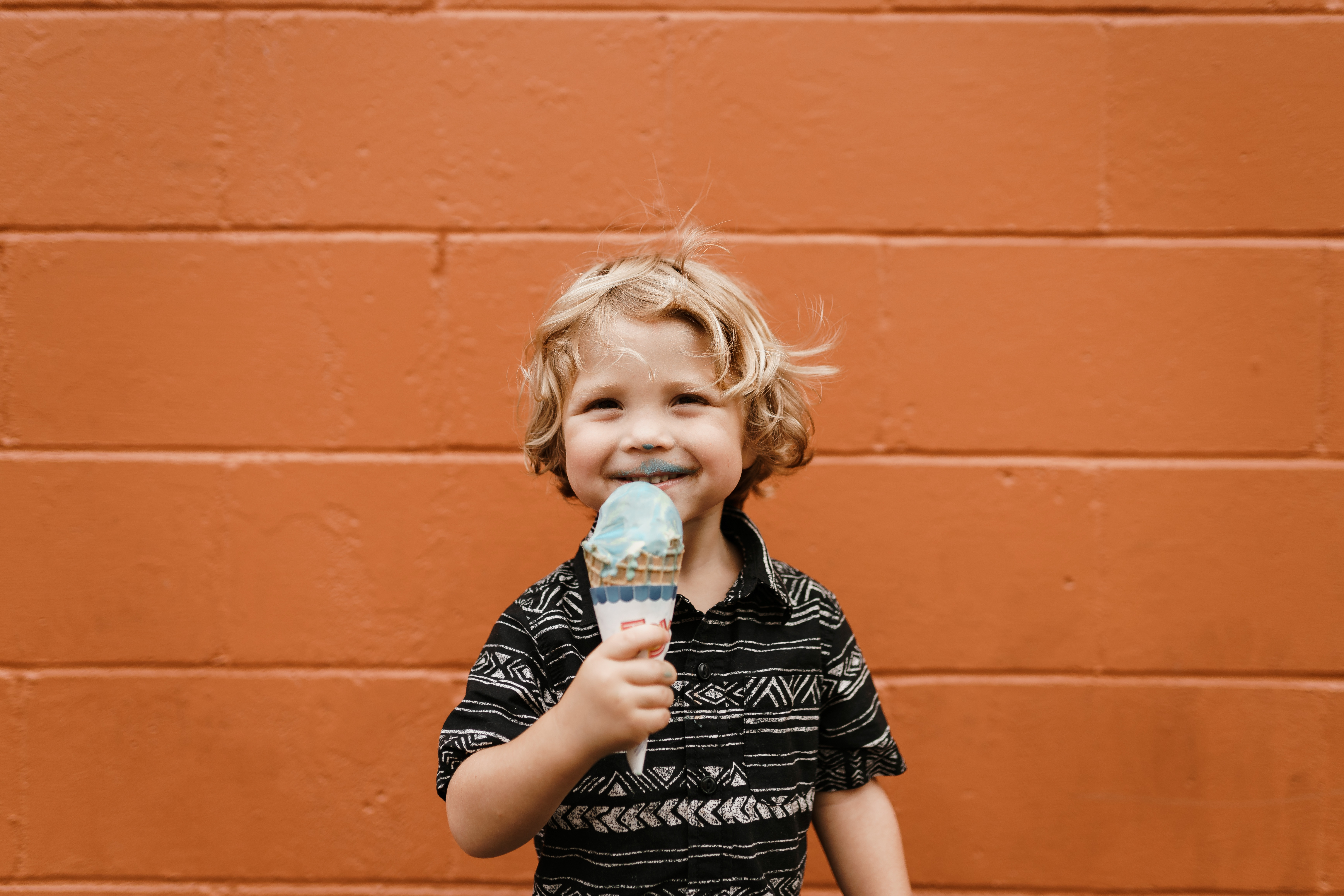 Smiling little boy eating ice cream.jpg