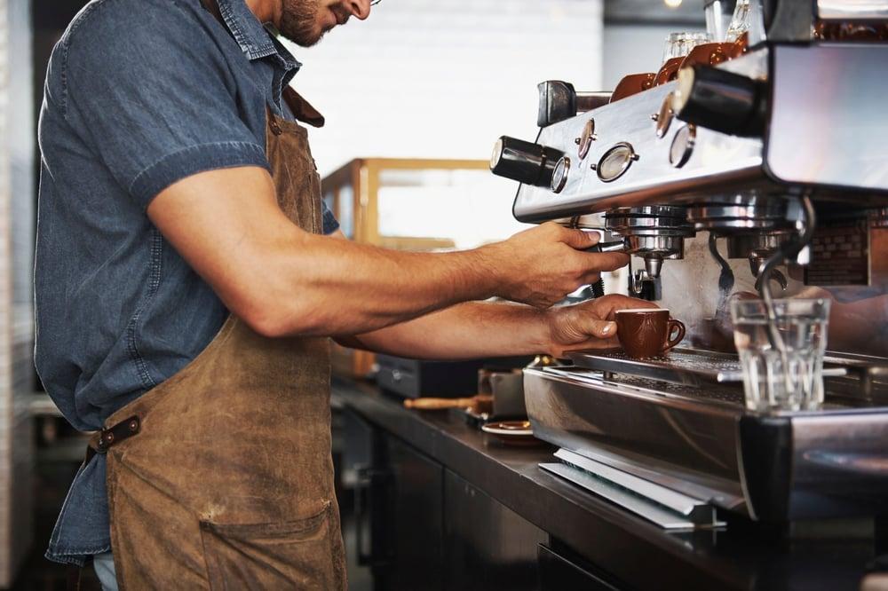 Male barista making coffee