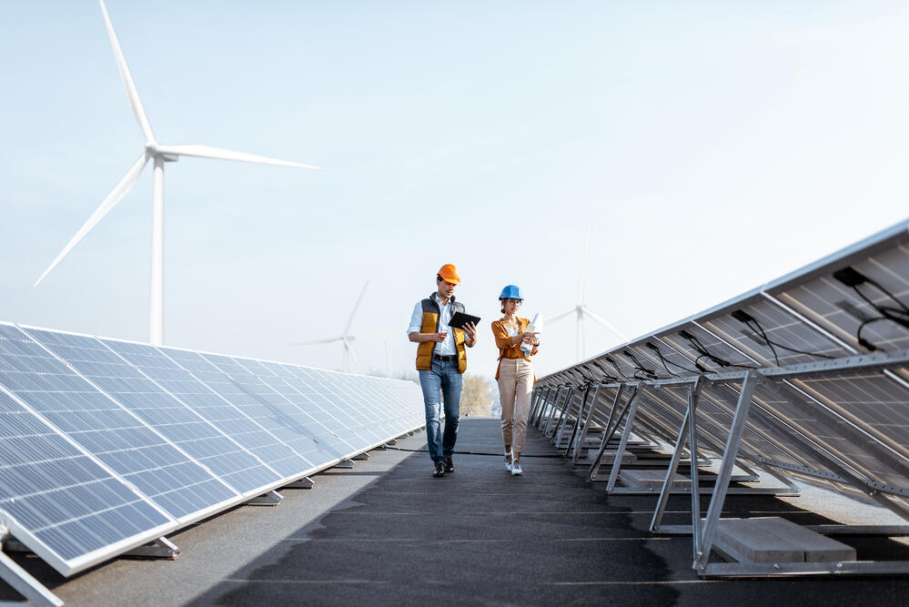 Two engineers with solar panels