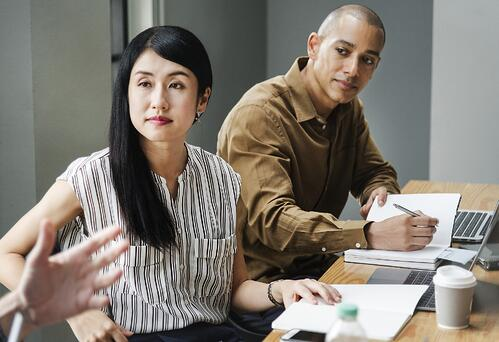 Man and woman at business meeting