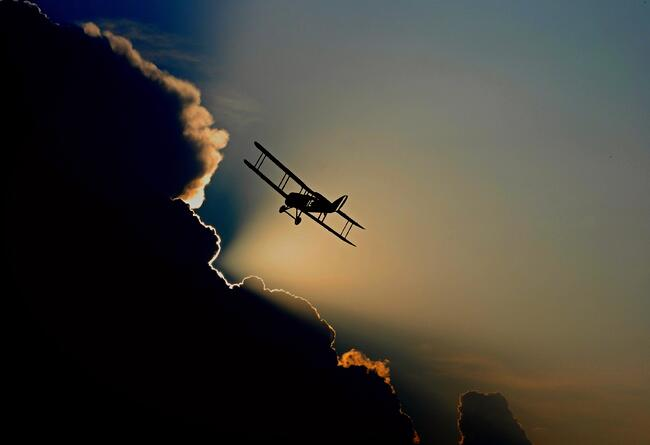 Biplane flying into clouds