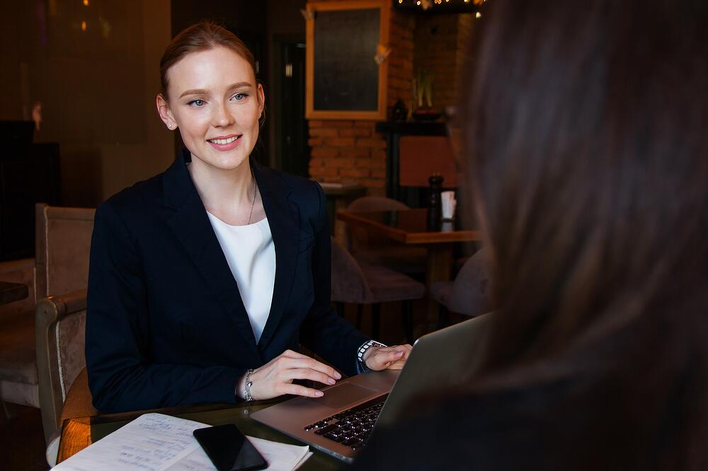Business woman having meeting with another woman in restaurant